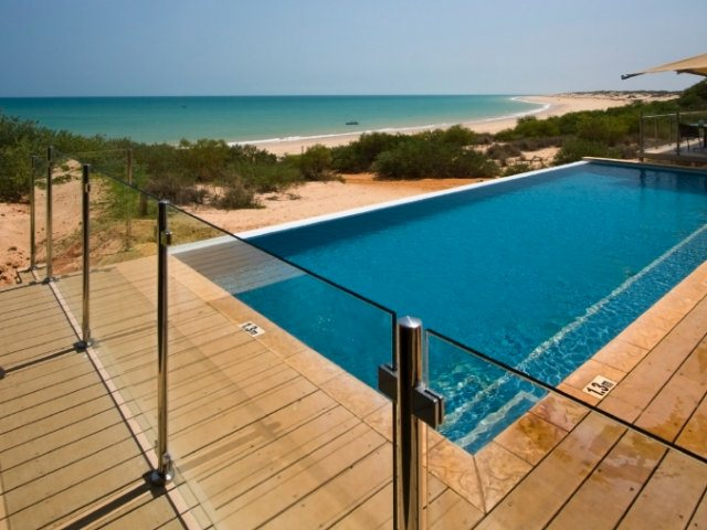 Glass coating for pool fence